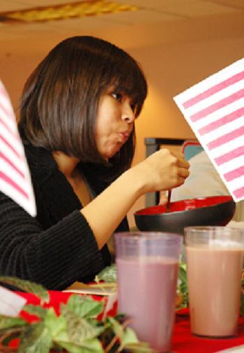 "Christine Aye 22, junior of Yangon, Burma, eats Malaysian chili during the ninth annual ""I Survived Chili Week"""