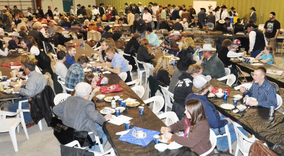 Hundreds of supporters of the Chadron State Rodeo team eat and bid on items at the Black Tie Calf Fry auction event at the Dawes County Fairgrounds Saturday February 19. — Photo by Vera Ulitina
