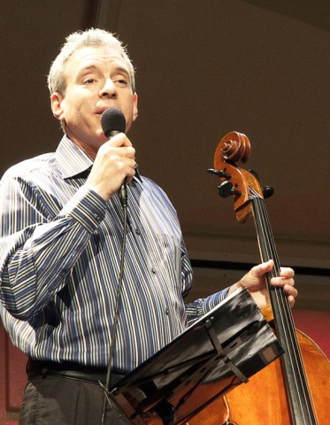 """Mark Summer, of Novato, speaks to the audience during the group's musical performance Tuesday evening. Novato plays the cello for the """"Turtle Island Quartet."""" — Photo by Ashley Swanson"""