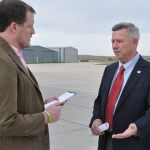 Gov. Dave Heineman talks with Kevin Oleksy, web editor for The Eagle, Friday, Oct. 21, at the Chadron Municipal Airport — Photo by Karisa Lamle