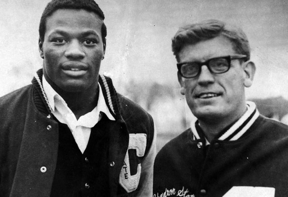 Holst stands with Chadron State discus-thrower Benny Francis prior to a National Association of Intercollegiate Athletics conference in 1967, at which Francis was a top contender. He broke the CSC record for discus at 174-5 in 1967 until his record was broken in 1998 by Dough Lytle with a throw of 175-5. &mdash Photo courtesy of Don Holst