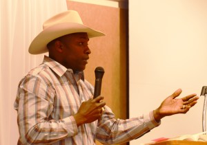 Fred Whitfield, eight-time world champion roper, speaks to the audience during his presentation Thursday in the Student Center Ballroom. —Photo by Teri Robinson