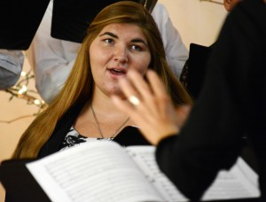 Stephanie Steele, senior of Osceloa, sings under the conduction of Una Taylor Sunday during the community choir concert at the Chadron Arts Center. —Photo by Jordyn Hulinsky