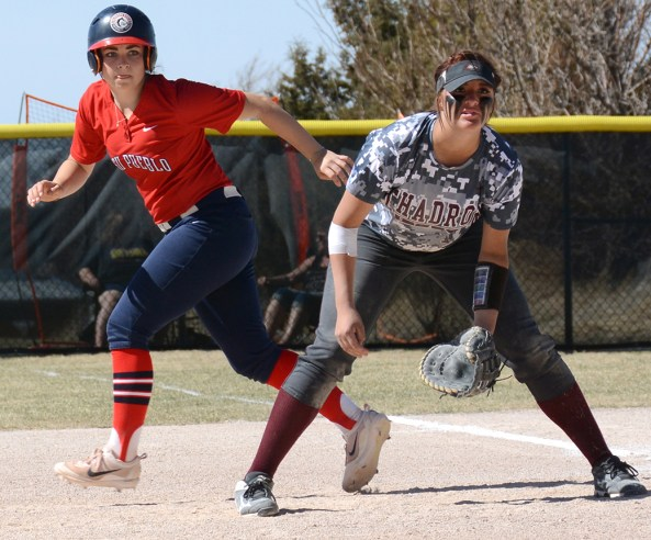 Moriah Turney, left, (17), sophomore of Brighton, Colorado, leads off from first base while Allie Mason (14), freshman of Loveland, Colorado, waits in anticipation for the next play during a game against the CSU-Pueblo ThunderWolves, Saturday.— Photo by Torri Brumbaugh