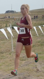 Alyse Henry, junior of Rock Springs, Wyoming, finishes in first, Saturday, at the Chadron State Invitational.