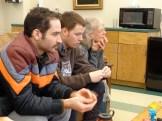 Art Teacher Nancy Schwartz and Graduate Fellows Dylan Fernandez and Greg Handley listen intently to a colleague.