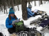 Ashley Marie and Maddie G. work on the first reading.