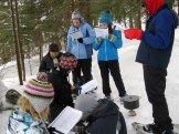 The group reads through a section of Endurance while waiting for the water to heat up for hot cocoa.