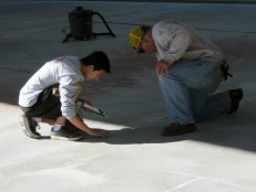 Kainoa helps prep the ice rink