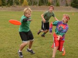 Dane, Charlie, and Joey playing Ultimate Frisbee