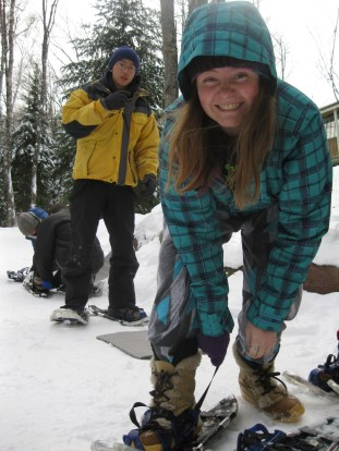 Erin straps on her snowshoes, ready to go!