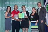 Park Elementary with award from Dept of Ed