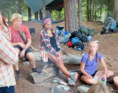 Charlie, Maren, and Avery enjoying time around the fire