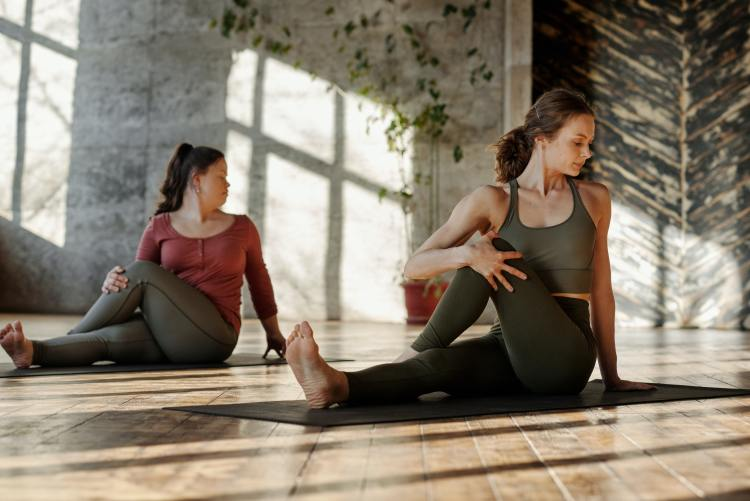 Two woman in yoga posee