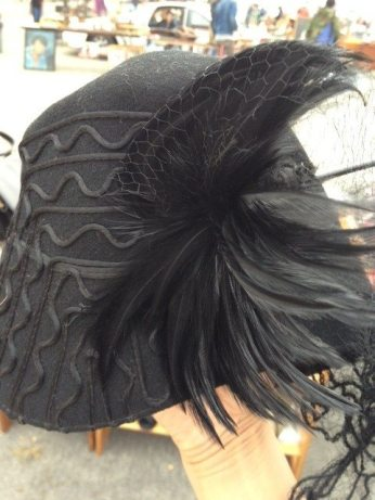 Black vintage hat with dramatic feathers