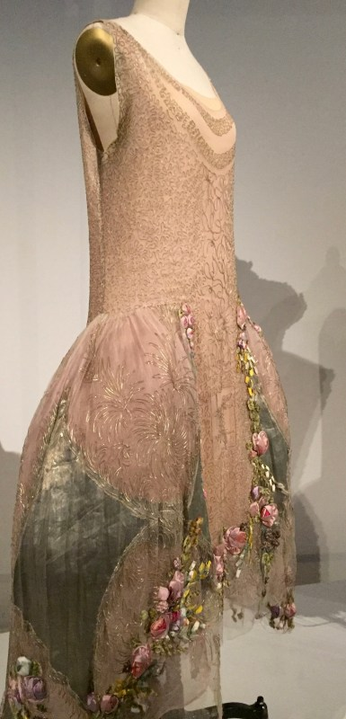 Manus x Machina - Boué Soeurs - Court presentation ensemble, 1928, haute couture - hand-sewn silk tulle, mahcine-embroidered with couched silver cord in a foliate and vermicelli pattern, machine-picot eding, hand-appliquéd with hand-embroidered silk tulle with artificial flowers