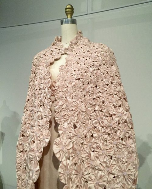 Manus x Machina - Chanel dress - 2010 - Karl Lagerfeld - pink silk chiffon and charmeuse, hand-embroidered with pink silk satin flowers, pearls, and pink-frosted crystals, hand-finished. Cape - 1,300 hand-pieced pink silk sating flowers by Lemarié with pink frosted crystals