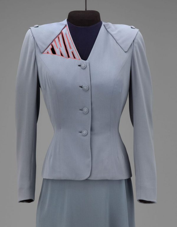 Transcontinental & Western Air hostess uniform by Howard Greer 1944 Collection of SFO Museum Gift of TWA Clipped Wings International, Inc. Photo credit: SFO Museum