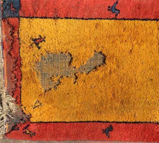 Wool rug eaten by moths