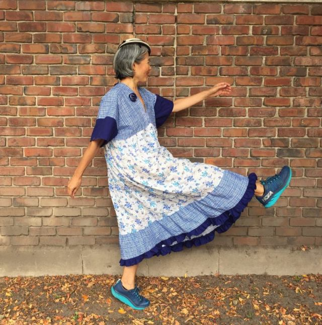 Parasol dress - pattern by Cris Wood Sews - Asian woman wearing color-blocked version in blue plaid, solid blue and white fabric printed with blue geometric designs and smal drawings