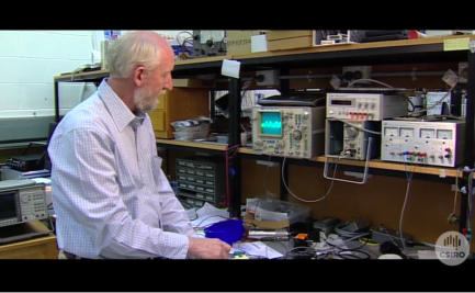 Keith Leslie at work in electronics laboratory.