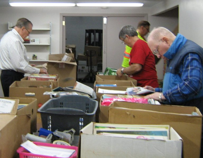 Volunteers sorting materials