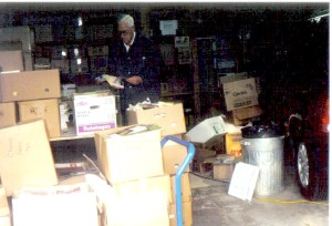 A drop-off volunteer's garage is filled with books