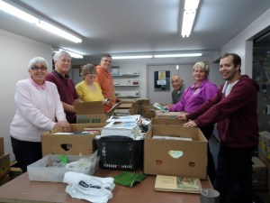 Volunteers sorting Bibles and books