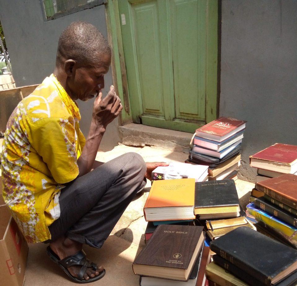 Man prays over books