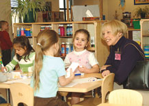 (U.S. Air Force photo/Liz Rankin) Susan James, wife of 14th Air Force commander, Lt. Gen. Larry James, takes a moment to visit with children at the Child Development Center here Jan. 22.