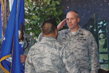 (U.S. Air Force photo/Staff Sgt. Amanda Delisle) Col. Edward Baron is given command of the 50th Mission Support Group from Col. Cary Chun, 50th Space Wing commander, during an assumption-of-command ceremony Feb. 24.