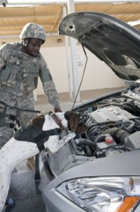 Staff Sgt. Zerrick Shanks and Haus conduct a vehicle sweep.