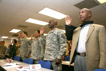 Soldiers and Family members take the Oath of Allegiance to become U.S. citizens Feb. 26 at Army Community Service.