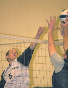 (U.S. Air Force photo/Scott Prater) Jeremy Brown, team captain for 4th Space Operations Squadron, attempts to win a point at the net in 4th SOPS' intramural league volleyball victory over previously unbeaten 2nd SOPS.