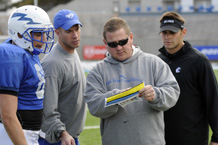 Coaching staff and players totally engage in gridiron strategy during practice Friday afternoon. Photos by Mike Kaplan