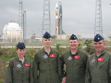 (Courtesy photo) 1st Lt. Katie Boeing, Staff Sgt. Aaron Summers, Capt. Jeff Pleinis and Lt. Col. Mike Kinslow, all from the 3rd Space Operations Squadron at Schriever AFB, pose for a photo in front of the United Launch Alliance Atlas V rocket on the morning of April 3. The rocket was used to launch the Air Force's second Wideband Global SATCOM satellite into orbit later that evening. 3rd SOPS will assume control of the satellite June 2009.