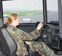 (U.S. Air Force photo/Master Sgt. Martie Moore) Airman 1st Class Janice Noel, 50th Comptroller Squadron, tests her driving skills in the simulator at the Save a Life Tour here April 3. The simulator recreated the sensation of driving under the influence of alcohol. The Save a Life Tour is an alcohol awareness program designed to educate people about the dangers of drinking and driving.