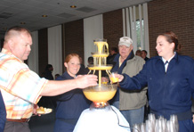 Army Col. Tom Bergfeld, left, Cadet Candidate Natalie Justice, Wayne MacKirdy and Cadet Candidate Mel Funk partake of the juice fountain during the sponsor appreciation reception in the Milazzo Club. (Photo by Ann Patton)