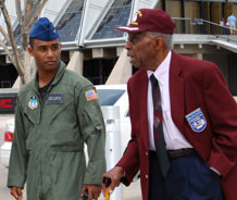 "Cadet 1st Class Harvey White III escorts Tuskegee Airman retired Col. Fitzroy ""Buck"" Newsum. Photo by Staff Sgt. Don Branum"