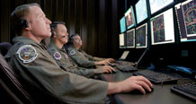 (U.S. Air Force photo/Capt. Carrie Kessler) Electronic warfare officers monitor a simulated test in the Central Control Facility at Eglin Air Force Base, Fla., April 16. They use the CCF to oversee electronic warfare mission data flight testing. Portions of their missions may expand under the new AFCYBER commander. Pictured are Lt. Col. Tim Sands, 53th Electronic Warfare Group AFCYBER Transition Team Chief, Capt. Jon Smith, 36th Electronic Warfare Squadron Suppression of Enemy Air Defenses test director, and Lt. Col. John Arnold, 36th Electronic Warfare Squadron commander