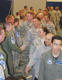(U.S. Air Force photo/Staff Sgt. Amanda Delisle) Airmen congratulate Schriever's newly-selected master sergeants during a party held at the Main Fitness Center May 15.