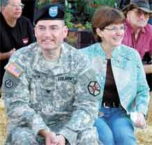 Courtesy photo  Garrison Commander Col. Eugene B. Smith and his wife, Fran, join the breakfast crowd at the Pikes Peak or Bust Rodeo Street Breakfast held downtown on Pikes Peak Avenue last year.