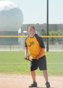 Jay Worrell, first baseman for Space Innovation and Development Center, prepares for a batter during SIDC's 19-5 win over 50th Security Forces Squadron June 22. Worrell hit his third home run of the season and finished with 6 RBI in the win.