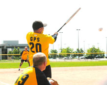 Eric Morales belts a line drive to right field during the 5th inning of 2nd SOPS' 23-9 victory over SIDC in the Schriever intramural softball league season opener for both teams.