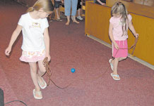 """Digging up God's Treasures activities at the Peterson Air Force Base Chapel June 17. The Limbough girls participated in the five-day vacation school that held a theme for each day. The June 17 theme was """"Show my Love for God by Loving my Parents."""""""