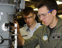 Maj. Douglas Bayley assists Cadet 1st Class Daniel O'Sullivan with a project in the U.S. Air Force Academy's astronautics laboratory Feb. 2, 2009. Photo by Dave Ahlschwede