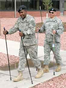 Sgt. Jose Cruz, Warrior Transition Battalion and wounded 4th Infantry Division Soldier, tries out the Nordic walking system Aug. 6 at the Soldier Family Assistance Center. WTB Command Sgt. Maj. Jim Bunch spots Cruz and tries the system out himself.
