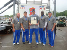 Academy's Firefighter Combat Challenge team competed in St. Louis last weekend, capturing third place in the team competition and bringing home gold in the relay event. (From left to right) Team Captain Roy Dalton, SrA Tyler Moran, Patrick Kraft, Anthony McMurtry, and Hans Barkley pose for a photo after receiving the first-place relay team award.