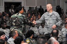 Chief Master Sgt. of the Air Force James Roy shakes hands with Tech. Sgt. Chamara Cantrell, 21st Dental Squadron, during a question and answer session Aug. 25 at the auditorium. Chief Roy spoke to a full house, addressing key focus areas such as training, base development, the 2009 Year of the Family, commitment to the Air Force community, and fulfilling Peterson's warfighting mission. (Air Force photo by Craig Denton)