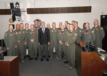 U.S. Sen. Mark Udall takes time out for a photo with men and women of the 3rd Space Operations Squadron during his visit to the base Sept. 2.